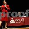 Rob Winner – rwinner@daily-chronicle.com<br /> <br /> States attorney candidate Sarah Gallagher Chami (left) introduces herself to the visitors of the DeKalb Chamber Candidates Night at the Egyptian Theatre in DeKalb, Ill. on Tuesday September 28, 2010, while her opponent Clay Campbell listens.