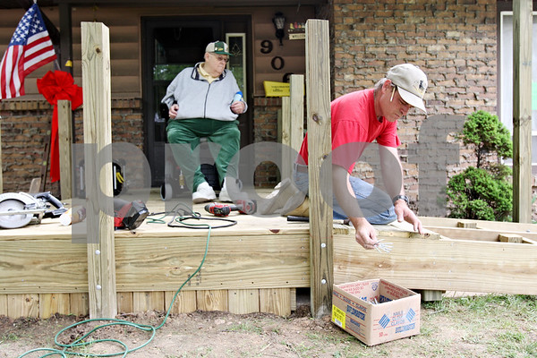 Rob Winner – rwinner@daily-chronicle.com<br /> <br /> Don Seitzinger (left) watches as fellow Mason, Dan Steffa (left), of Malta, helps  build a ramp at Seitzinger's home in DeKalb, Ill. on Saturday May 1, 2010.