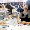 Rob Winner – rwinner@daily-chronicle.com<br /> <br /> Ashly Bieche (right), 16, works on an artist trading card at Sycamore High School in Sycamore, Ill. on Friday May 21, 2010.