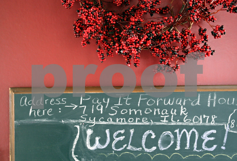 Beck Diefenbach - bdiefenbach@daily-chronicle.com<br /> <br /> A welcome sign in the kitchen of the Pay-It Forward House in Sycamore, Ill., on Tuesday March 9, 2010. The Pay It Forward House provides family members of local hospital patients with inexpensive short term accommodations.