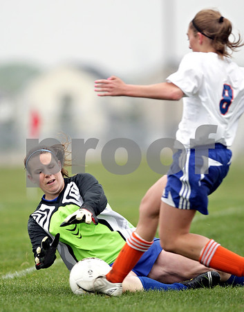 Beck Diefenbach  -  bdiefenbach@daily-chronicle.com<br /> <br /> Galena/River Ridge's goal keeper blocks a shot by Genoa-Kingston's Ariel Rylko (8, right) during the first half of the game at G-K High School in Genoa, Ill., on Tuesday May 11, 2010. G-K defeated Galena/River Ridge 8 to 1.