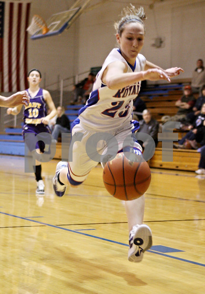 Rob Winner – rwinner@daily-chronicle.com<br /> <br /> Hinckley-Big Rock's Alyssa Baunach saves a loose ball during the first quarter in Hinckley on Tuesday night.