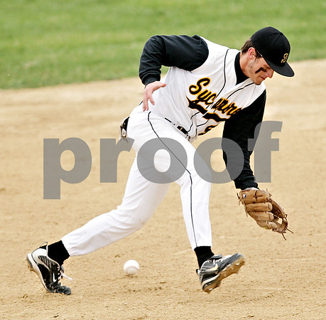 Beck Diefenbach  -  bdiefenbach@daily-chronicle.com<br /> <br /> Sycamore's Eric Ray (5) misses a ground ball during the first inning of the game against DeKalb at Sycamore Park in Sycamore, Ill., on Thursday April 8, 2010.