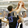 Rob Winner – rwinner@daily-chronicle.com<br /> <br /> Hinckley-Big Rock's Justin Salazar (13) and Kaneland's Daniel Helm (40) try to control a rebound under the Knights' basket in the first quarter of their game during the Christmas Classic in Plano on Monday. Kaneland went on to defeat Hinckley-Big Rock, 66-33.