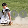 Beck Diefenbach  -  bdiefenbach@daily-chronicle.com<br /> <br /> Sycamore's Zack Spiewak (2) reacts misses a ground ball during the third inning of the game against Batavia at Sycamore Park in Sycamore, Ill., on Wednesday April 21, 2010. Batavia defeated Sycamore 4 to 2.