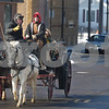 Kyle Bursaw – kbursaw@daily-chronicle.com<br /> <br /> Kendra Barnes, right, steers the horses as John Hart, the owner of the horses, looks on. Hart and Barnes took residents for free carriage rides around the downtown DeKalb area on Saturday, Dec. 18, 2010.