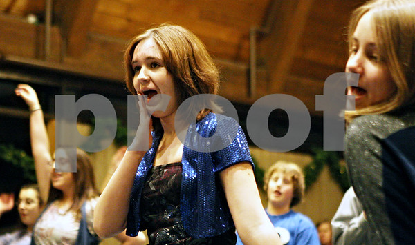"""Rob Winner – rwinner@daily-chronicle.com<br /> <br /> Erin Laino, 14 of DeKalb, practices a scene from """"Thoroughly Modern Millie"""" with fellow cast members during rehearsal at Westminster Presbyterian Church in DeKalb on Monday night."""