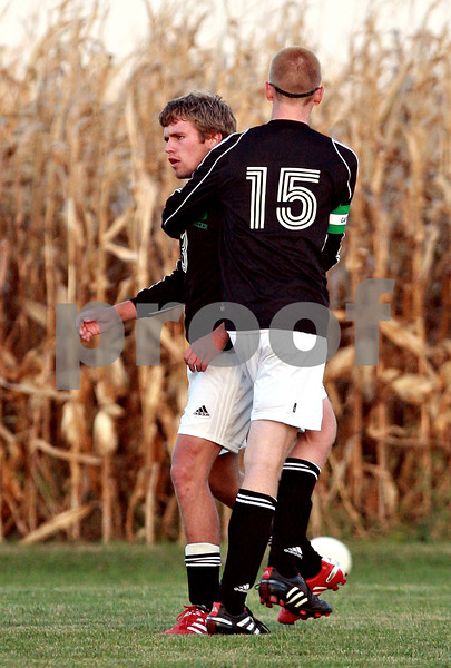Beck Diefenbach – bdiefenbach@daily-chronicle.com<br /> <br /> Earlville-Leland's Chris Collins (3, left) is held back by Reed Goodbred (15) after shoving a H-BR's Avery Rifiorgiate (39, not pictured) after Rifiorgiate had shoved E-L's Tom Johnson (not pictured) during the second half of the Little 10 Conference tournament game at H-BR High School in Hinckley, Ill., on Wednesday Oct. 6, 2010. Both E-L's (3) and H-BR's (39) received red cards and were ejected from the game.