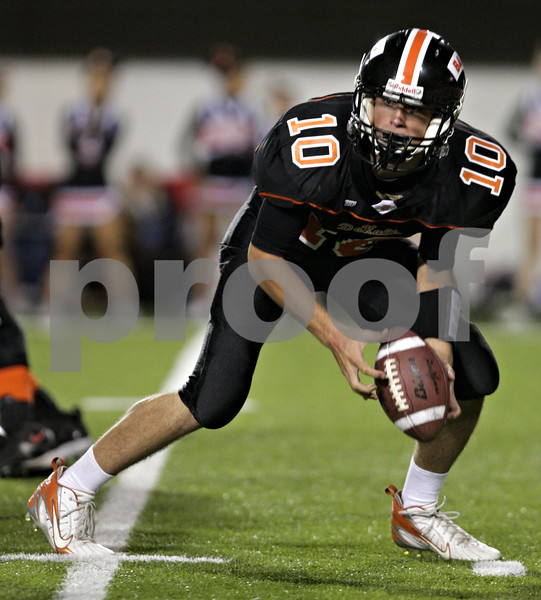 Beck Diefenbach – bdiefenbach@daily-chronicle.com<br /> <br /> DeKalb quarterback Brian Sisler (10) retrieves his own fumble during the second quarter of the Castle Challenge football game between DeKalb and Sycamore High Schools at Huskie Stadium on the campus of Northern Illinois University in DeKalb, Ill., on Friday Sept. 10 2010.