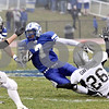 Wendy Kemp - For The Chronicle<br /> <br /> Kaneland's Kyle Davidson (26) takes down Vernon Hills' Evan Spencer during Saturday's playoff game at Vernon Hills High School.