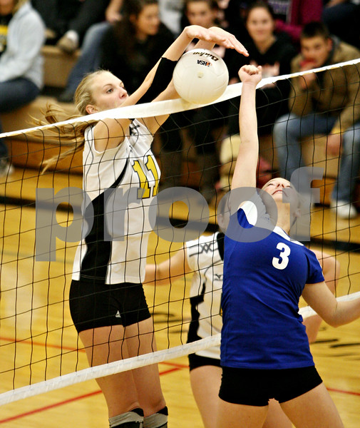 Rob Winner – rwinner@daily-chronicle.com<br /> <br /> Sycamore's Evyn McCoy blocks a ball from Burlington Central's Molly Harrison during their second game in Maple Park, Ill. on Thursday October 28, 2010. Sycamore went on to defeat Burlington Central, 25-17 and