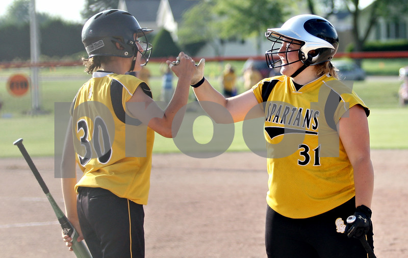 Rob Winner – rwinner@daily-chronicle.com<br /> <br /> After scoring the go-ahead run, Sycamore's Anna Buzzard (30) is congratulated by teammate Rachel Lesorgen in the top of the seventh inning during the IHSA Class 3A DeKalb Sectional semifinal on Wednesday June 2, 2010 in DeKalb, Ill.