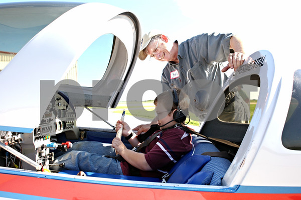Rob Winner – rwinner@daily-chronicle.com<br /> <br /> Tucker Hoffman, 9, of Sycamore, prepares for a Young Eagles flight in a Lancair 320 with Jim Auman on Saturday August 14, 2010 at the DeKalb Taylor Municipal Airport in DeKalb, Ill.