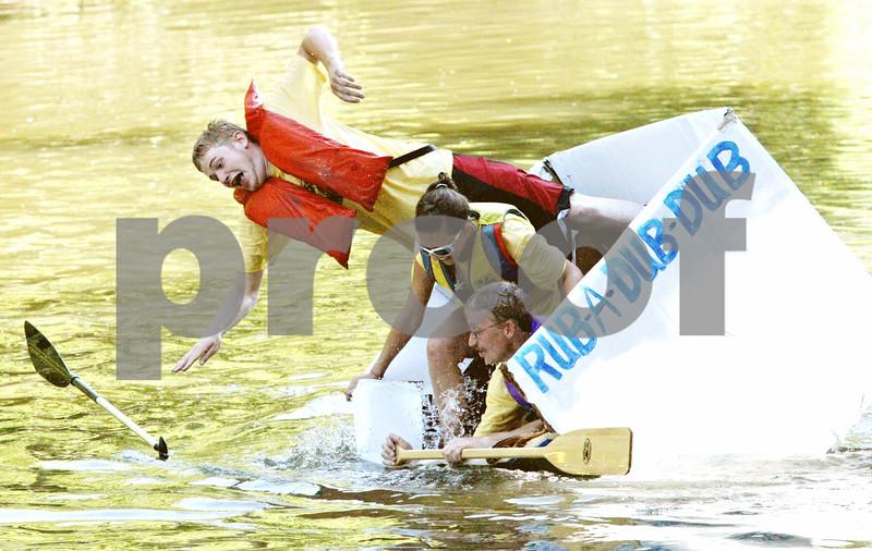 Rob Winner Ð rwinner@daily-chronicle.com<br /> <br /> Genoa resident Jason Hauser (top) abandons his vessel and jumps into the Kishwaukee River during the Kingston Fest 2010 Kardboard Boat Regatta on Saturday July 17, 2010 in Kingston, Ill.