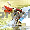 Rob Winner Ð rwinner@daily-chronicle.com<br /> <br /> Genoa resident Jason Hauser (top) abandons his vessel and jumps into the Kishwaukee River during the Kingston Fest 2010 Kardboard Boat Regatta on Saturday July 17, 2010 in Kingston, Ill.