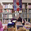 Beck Diefenbach  -  bdiefenbach@daily-chronicle.com<br /> <br /> Pat Emling, center, of Kirkland, sifts through quilting magazines during the Stop and Swap event where people can trade quilting literature and materials at the Genoa Public Library in Genoa, Ill., on Monday Jan. 25, 2010.