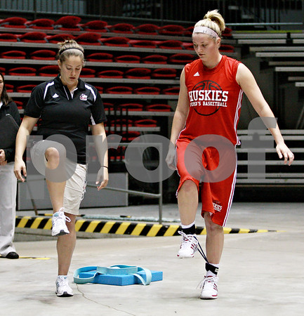 Beck Diefenbach – bdiefenbach@daily-chronicle.com<br /> <br /> Northern Illinois' Jenna Thorp (right) with training student Lauren Hall during her team's first practice of the season at NIU's Convocation Center in DeKalb, Ill., on Monday Oct. 4, 2010.