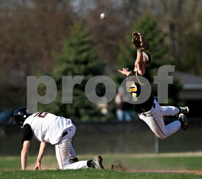 Beck Diefenbach  -  bdiefenbach@daily-chronicle.com<br /> <br /> Sycamore's Eric Ray (5, right) leaps, but cannot catch the ball as DeKalb's Nate Diedrich (2, left) slides safe at second base during the second inning of the game at DeKalb High School in DeKalb, Ill., on Friday April 9, 2010.