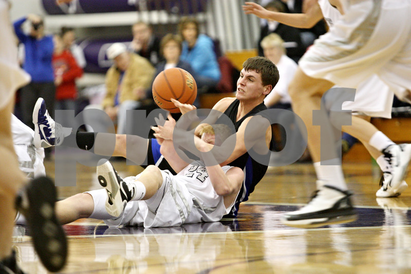 Rob Winner – rwinner@daily-chronicle.com<br /> <br /> Hinckley-Big Rock's Justin Salazar (top) fouls Kaneland's Kory Harner after struggling for a loose ball in the second quarter of their game during the Christmas Classic in Plano on Monday. Kaneland went on to defeat Hinckley-Big Rock, 66-33.