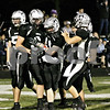 Wendy Kemp - For The Kane County Chronicle<br /> Teammates congratulate Kaneland's Tyler Callaghan after making a touchdown during Friday's playoff game against King College Prep.<br /> Maple Park 10/29/10