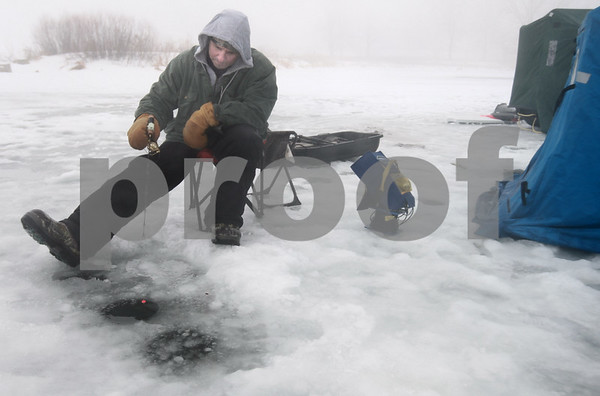 Kyle Bursaw – kbursaw@daily-chronicle.com<br /> <br /> Mark Dalki waits for a bite while ice fishing on Shabbona Lake on Thursday, Dec. 30, 2010.