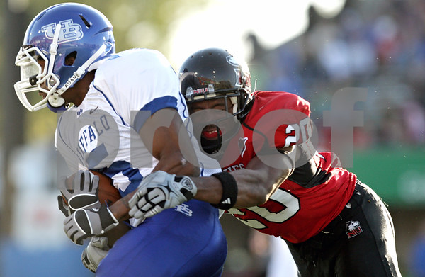 Rob Winner – rwinner@daily-chronicle.com<br /> <br /> Buffalo wide receiver Terrell Jackson (5) is tackled from behind by Northern Illinois cornerback Tommie Davis during the third quarter of their game in DeKalb, Ill. on Saturday October 16, 2010.