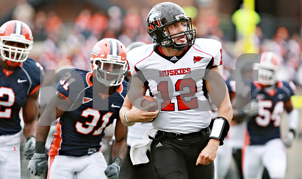 Rob Winner – rwinner@daily-chronicle.com<br /> <br /> Northern Illinois quarterback Chandler Harnish looks toward the stands while rushing for a touchdown in the first half of their game in Champaign, Ill.  on Saturday September 18, 2010.