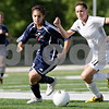 Rob Winner – rwinner@daily-chronicle.com<br /> <br /> Saint Viator's Taylor Skala (left) and Sycamore's Katelyn Brown chase after a ball during the first half of the IHSA Class 2A Barrington Super-Sectional on Tuesday June 1, 2010 in Barrington, Ill. Saint Viator defeated Sycamore, 3-0.