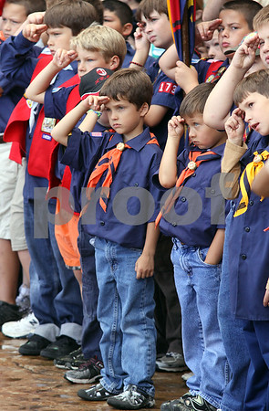 Wendy Kemp - For The Daily Chronicle<br /> Jacob Larsen, 6, (center) of Cortland Boy Scout Pack 134, gives a salute during the 911 Memorial Service in the healing garden of Kishwaukee Hospital on Saturday.<br /> DeKalb 9/11/10