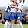 Beck Diefenbach  -  bdiefenbach@daily-chronicle.com<br /> <br /> Hinckley-Big Rock's Jess Meyer (17, left) and Alyssa Baunach (26, right) congratulate Megan Gregg (20) following Gregg's goal during the first half of the game against Mendota at H-BR in Hinckley, Ill., on Tuesday May 18, 2010.