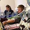 Beck Diefenbach  -  bdiefenbach@daily-chronicle.com<br /> <br /> Northern Illinois University student Philip Moe watches as his blood is drawn and sent through a centrifuge as he donates bone marrow at Rock River Valley Blood Center in Rockford, Ill., on Thursday Feb. 18, 2010. Last April, Moe registered with the National Bone Marrow Donor Registry at NIU and was found to be a match with a needy patient.