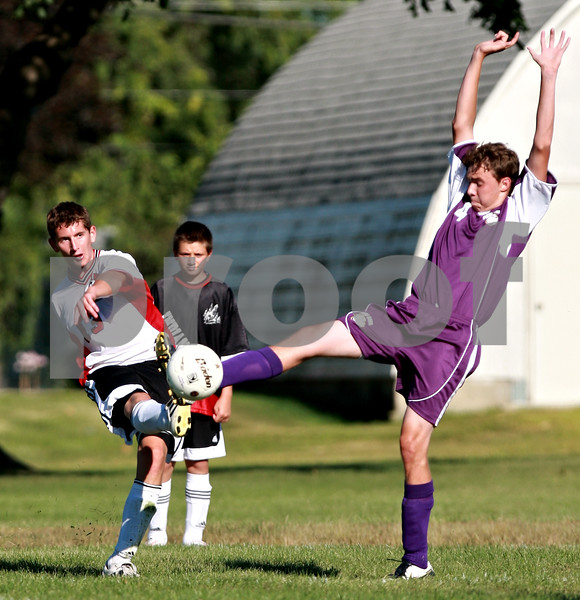Beck Diefenbach  -  bdiefenbach@daily-chronicle.com<br /> <br /> Indian Creek's David Drendel (13, left) kicks the ball around Paw Paw's Justin Wiley (4) during the first half of the game at Waterman middle School in Waterman, Ill., on Thursday Aug. 26, 2010. Indian Creek defeated Paw Paw 6 to 2.