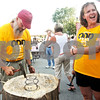 "Beck Diefenbach - bdiefenbach@daily-chronicle.com<br /> <br /> Julie Repp (right) reacts as Order of Odd Fellows member Rick Baker (left) finishes his turn at a game of ""nails"" during Oddfest in Sycamore, Ill., on Saturday Aug. 21, 2010."
