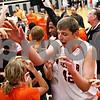 Beck Diefenbach - bdiefenbach@daily-chronicle.com<br /> <br /> DeKalb's Jordan Threloff celebrates with fans after defeating Kaneland in the IHSA Class 3A Regional championship game at Kaneland High School in Maple Park, Ill., on Friday March 3, 2010.
