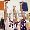Beck Diefenbach  -  bdiefenbach@daily-chronicle.com<br /> <br /> Genoa-Kingston's Scott Suchy (20, left) shoots the ball above Hampshire's Ryan Burke (34, center) and Tyler Watzlawick (44) during the fourth quarter of the game at Genoa-Kingston High School in Genoa, Ill., on Monday Jan. 11, 2009. Hampshire defeated G-K 57 to 52.