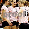 Rob Winner – rwinner@daily-chronicle.com<br /> <br /> Courtney Thomas (21) celebrates a DeKalb point with her teammates during the first game against Kaneland in DeKalb, Ill. on Tuesday October 12, 2010. DeKalb went on to defeat Kaneland, 25-18 and 25-11.