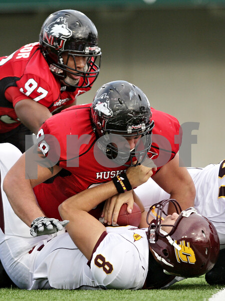 Rob Winner – rwinner@daily-chronicle.com<br /> <br /> Northern Illinois defensive tackle D.J. Pirkle sacks Central Michigan quarterback Ryan Radcliff during the second quarter in DeKalb, Ill. on Saturday October 23, 2010. DeKalb went on to defeat Central Michigan, 33-7.