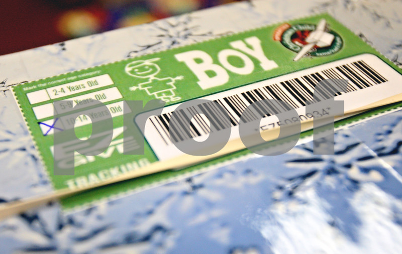 Rob Winner – rwinner@daily-chronicle.com<br /> <br /> A box filled with gifts is marked for a 10-14 year old boy and includes a barcode so it can be tracked to see where in the world it ends up.