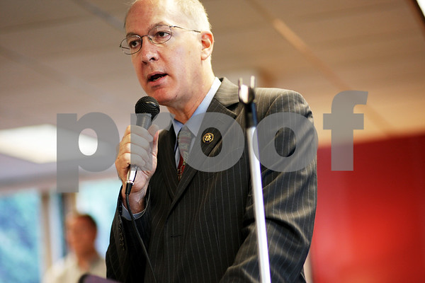 Beck Diefenbach - bdiefenbach@daily-chronicle.com<br /> <br /> U.S. congressman Bill Foster (right) speaks during a dinner celebrating the completion of the water pipe replacement project at Golden Years Plaza in DeKalb, Ill., on Monday Aug. 23, 2010.