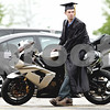 Rob Winner – rwinner@daily-chronicle.com<br /> <br /> Jason Gomes, of Dixon, leans against his motorcycle before the start of the Kishwaukee College commencement ceremony on Saturday May 15, 2010 in Malta, Ill.