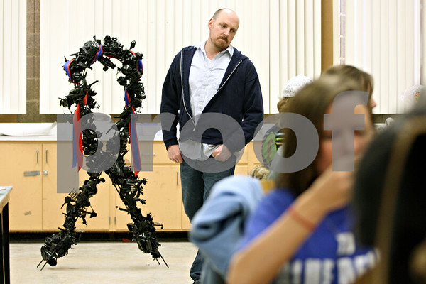 "Rob Winner – rwinner@daily-chronicle.com<br /> Students of art instructor Ben Stone (left) at NIU have created a sculpture titled ""Parcelles d'espoir,"" which will be auctioned off beginning this weekend with all of the proceeds benefiting the Haiti relief effort.<br /> DeKalb, Ill. <br /> 02/18/2010"