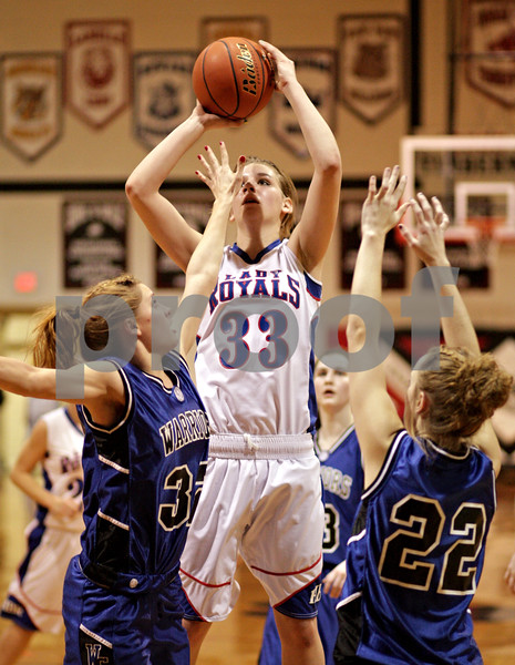Beck Diefenbach – bdiefenbach@daily-chronicle.com<br /> <br /> Hinckley-Big Rock's Tess Godhardt (center) shoots the ball over Westminster's Katie Moeller (32, left) during the second quarter of the IHSA Class 1A Regional playoff game at Indian Creek High School in Shabbona, Ill., on Wednesday Feb. 10, 2010.