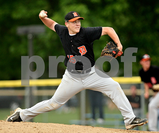 Beck Diefenbach  -  bdiefenbach@daily-chronicle.com<br /> <br /> DeKalb's Ben Dallesasse (15) winds up during the third inning of the game against Geneva at Geneva High School in Geneva, Ill., on Thursday May 13, 2010. DeKalb defeated Geneva 5 to 3.
