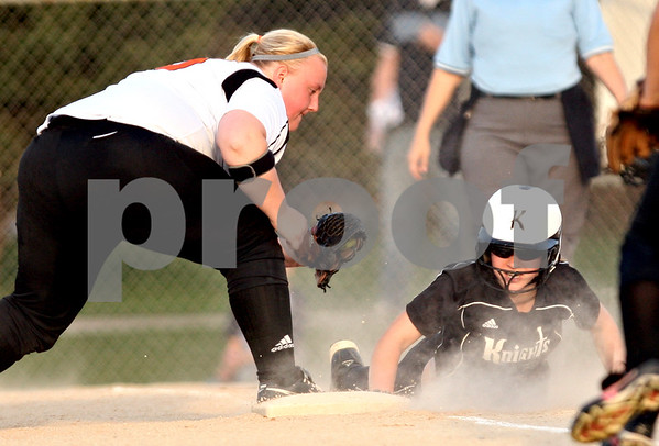 Beck Diefenbach  -  bdiefenbach@daily-chronicle.com<br /> <br /> Kaneland's Allyson O'Herron (4, right) slides past DeKalb's Vicki Vonbergen (19) to be safe at third base after attempting to make it home during the sixth inning of the game at DeKalb High School in DeKalb, Ill., on Tuesday April 13, 2010.