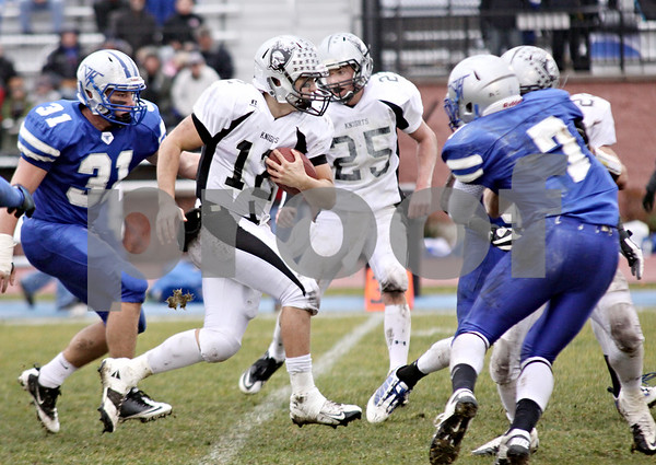 Wendy Kemp - For The Chronicle<br /> <br /> Kaneland quarterback Joe Camiliere runs with the ball during Saturday's playoff game against Vernon Hills High School.