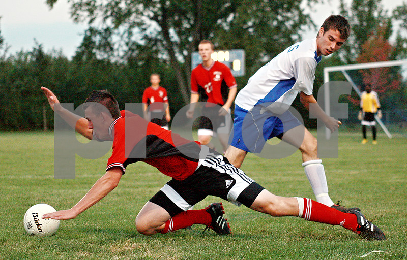 Beck Diefenbach – bdiefenbach@daily-chronicle.com<br /> <br /> Indian Creek's Dillon Martenson (9, left) trips as Hinckley-Big Rock's Tim Engel (21) battles for the ball during the first half of the game against Hinckley-Big Rock at Hinckley-Big rock High School in Hinckley, Ill., on Monday Sept. 20, 2010.