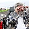 Beck Diefenbach  -  bdiefenbach@daily-chronicle.com<br /> <br /> Chauncey Watson a friend's glasses to view his home as it destroyed by fire in rural DeKalb, Ill., on Friday April 30, 2010. Watson's glasses were lose when he was blown several feet after his home exploded.