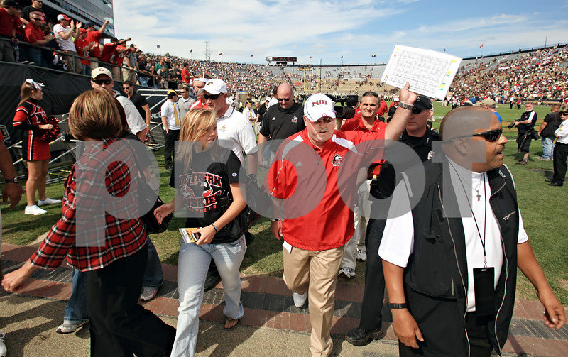 Chronicle File Photo<br /> <br /> Northern Illinois head coach Jerry Kill celebrates the defeat of Purdue University in West Lafayette, Ind., on Saturday Sept. 19, 2009