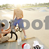 Beck Diefenbach  -  bdiefenbach@daily-chronicle.com<br /> <br /> Bailey Fessler (left), 13, of Ottowa and his friend Jacob Nolan, 13, of Ottowa, try to fix Nolan's bike's brakes while at the skate park in Katz Park in DeKalb, Ill., on Wednesday July 14, 2010.
