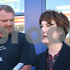 Dana Herra - dherra@daily-chronicle.com<br /> <br /> Ron Steger of DeKalb looks on while Illinois Lottery Acting Superintendent Jodie Winnett answers a question at a press conference Friday morning at Road Ranger in DeKalb. Winnett presented Steger with an oversized check for the $4.5 million Lottery jackpot he won in September.
